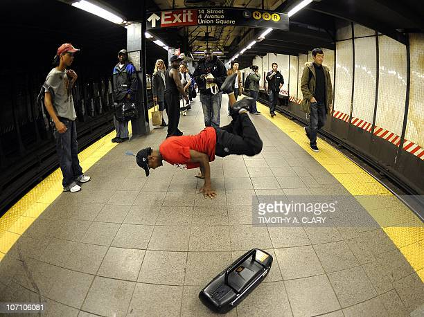 CULTURE by Sebastian Smith New York City Subway dancer Tamiek Steele performs acrobatic tricks on the subway while passengers watch November 23 2010...