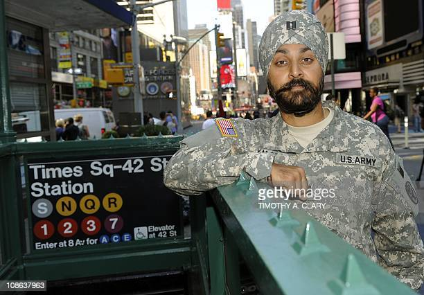 STORY by Shaun Tandon USMILITARYRELIGIONSIKHSUS Army Captain Kamaljeet Singh Kalsi poses in Times Square New York on September 14 wearing his US Army...