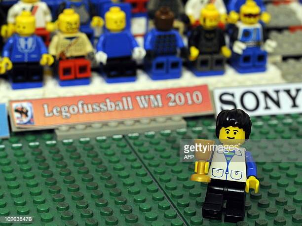 STORY by SIMON STURDEE A Lego figure representing Germany's head coach Joachim Loew holds a trophy in the 'LegoStadium' set up by 19yearold Fabian...