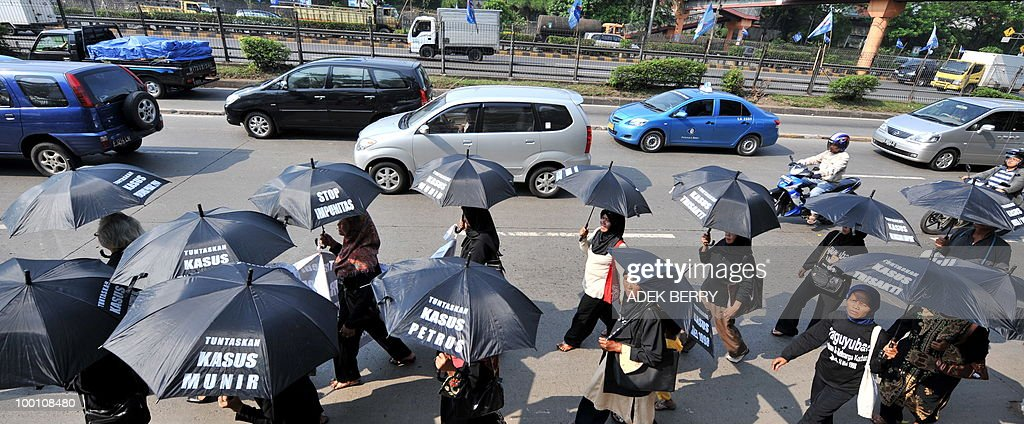 By STEPHEN COATES Indonesian activists march toward the parliament holding umbrellas with protest banners marking the anniversary of the downfall of military strongman Suharto in Jakarta on May 21, 2010. Twelve years after the dawning of Indonesia's 'Reformasi' movement with the resignation of military strongman Suharto, there are fears the country of 240 million people is on a slipperly slope backwards.