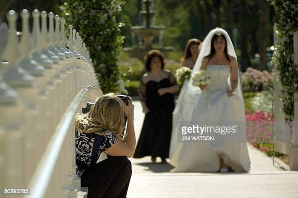 MARRIAGE by Virginie Montet A Disney wedding photographer captures pictures of bride Lauren Cappell followed by her wedding party crossing over the...