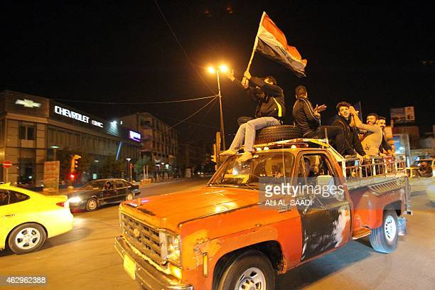 STORY by WG Dunlop IraqSyriaconflictUSBaghdadcurfew Iraqis celebrate on February 8 the lift of curfew in central Baghdad Iraqis roared through...