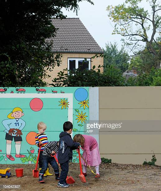 STORY by YANNICK PASQUET Children play in front of noise protection wall in a kintergarten in the northern German city of Hamburg on September 12...