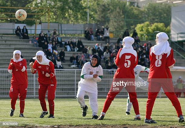 STORY by YANNICK PASQUET FILES A picture taken on April 28 2006 shows players from Iran's women national football team fighting for the ball with...