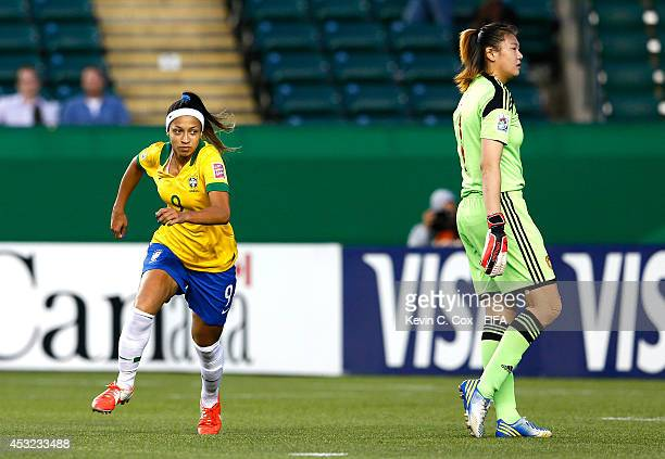 Byanca of Brazil reacts after scoring a goal against goalkeeper Lu Feifei of China PR in the second half at Commonwealth Stadium on August 5 2014 in...