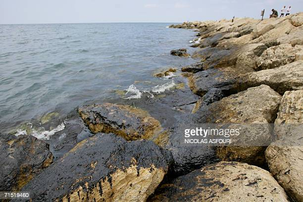 Pools of oil disfigure a beach in the bay of Byblos 42 kms north of Beirut 26 July 2006 ten days after an Egyptian vessel was hit and set ablaze...