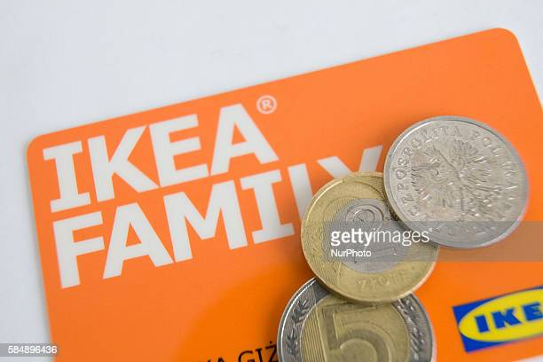 POLAND Bydgoszcz July 31 2016 An Ikea loyalty card is seen with Euro's and Polish Zloty coins