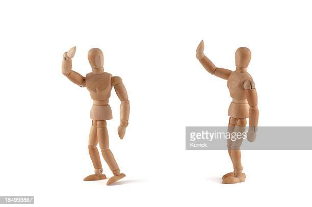 Bye - wooden mannequins waves to somebody