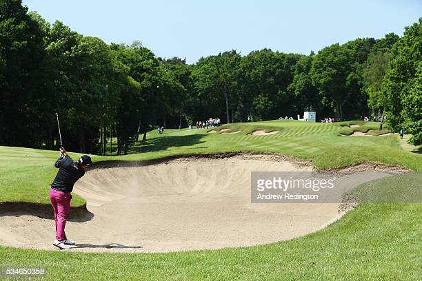 Byeong Hun An of Korea hits his 2nd shot on the 1st hole during day two of the BMW PGA Championship at Wentworth on May 27 2016 in Virginia Water...