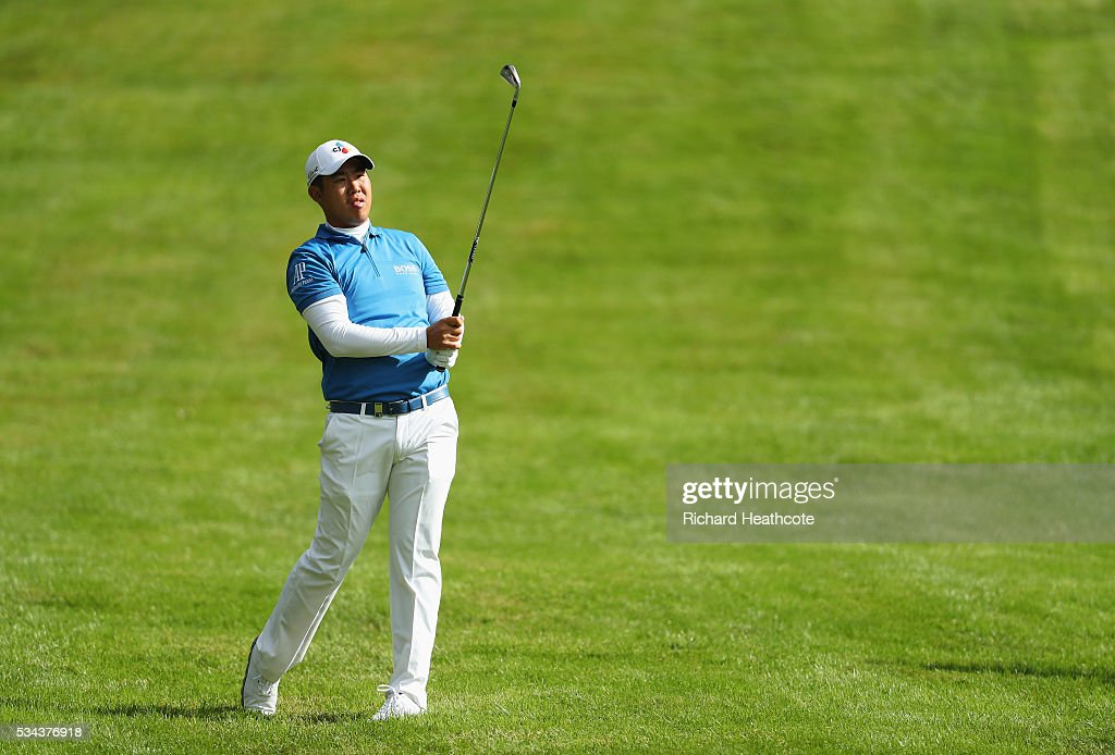 Byeong Hun An of Korea hits his 2nd shot on the 4th hole during day one of the BMW PGA Championship at Wentworth on May 26, 2016 in Virginia Water, England.
