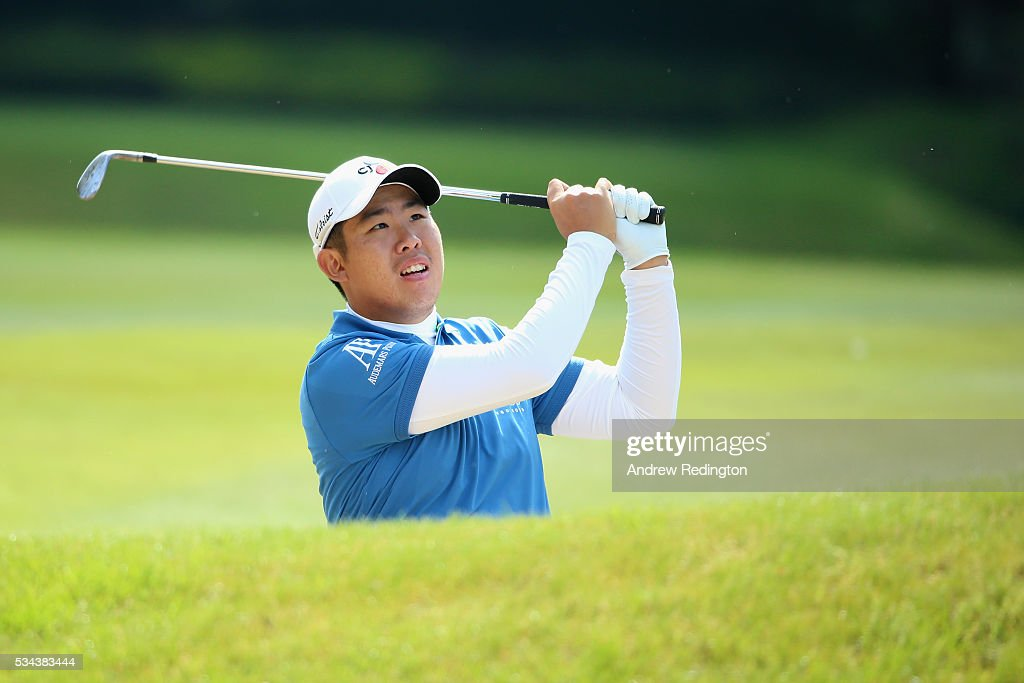 Byeong Hun An of Korea hits his 2nd shot on the 9th hole during day one of the BMW PGA Championship at Wentworth on May 26, 2016 in Virginia Water, England.