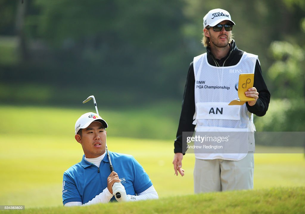 Byeong Hun An of Korea looks down the 9th hole with his caddie during day one of the BMW PGA Championship at Wentworth on May 26, 2016 in Virginia Water, England.