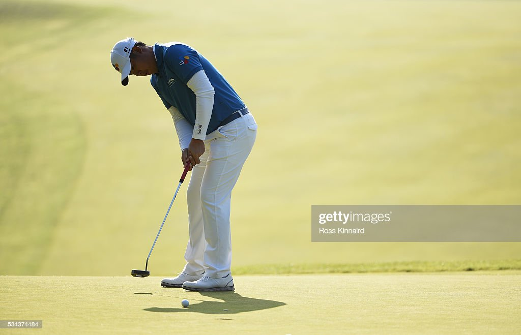 Byeong Hun An of Korea putts on the 1st green during day one of the BMW PGA Championship at Wentworth on May 26, 2016 in Virginia Water, England.