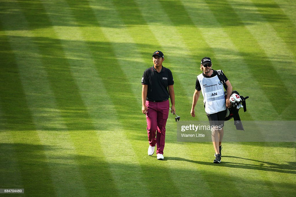 Byeong Hun An of Korea walks up the 18th hole during day two of the BMW PGA Championship at Wentworth on May 27, 2016 in Virginia Water, England.