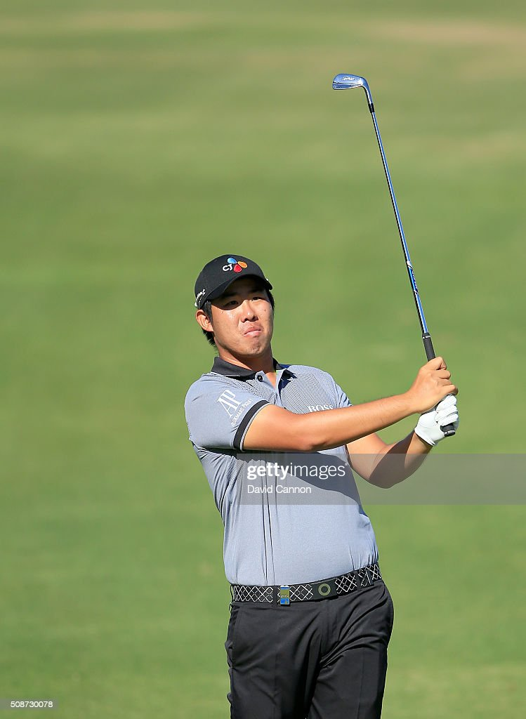 Byeong Hun An of South Korea plays his second shot at the par 4, 14th hole during the third round of the 2016 Omega Dubai Desert Classic on the Majlis Course at the Emirates Golf Club on February 6, 2016 in Dubai, United Arab Emirates.