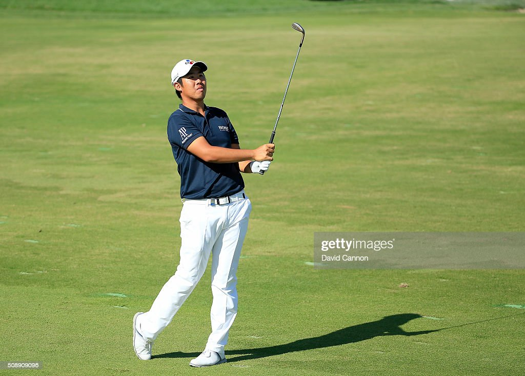 Byeong Hun An of South Korea plays his second shot at the par 4, 17th hole during the final round of the 2016 Omega Dubai Desert Classic on the Majlis Course at the Emirates Golf Club on February 7, 2016 in Dubai, United Arab Emirates.
