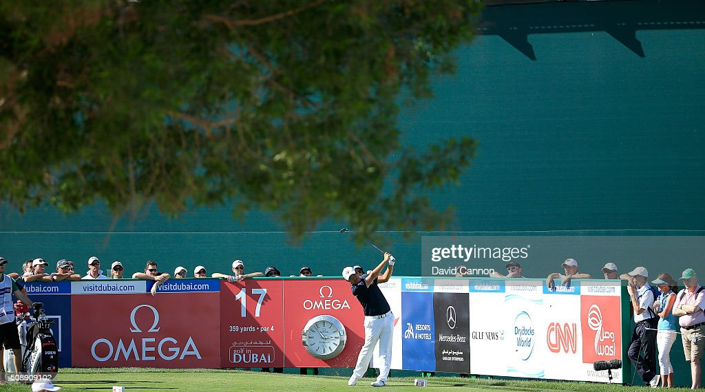 Byeong Hun An of South Korea plays his tee shot at the par 4, 16th hole during the final round of the 2016 Omega Dubai Desert Classic on the Majlis Course at the Emirates Golf Club on February 7, 2016 in Dubai, United Arab Emirates.