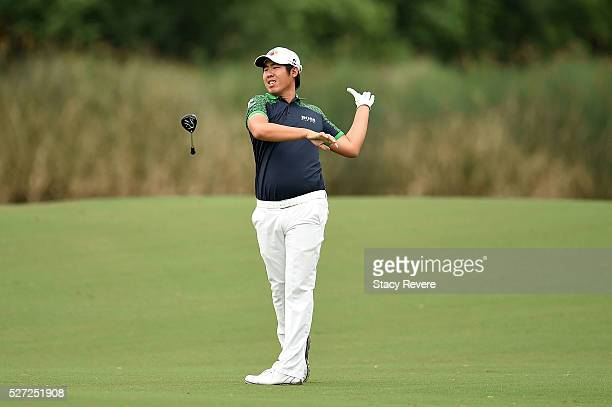 ByeongHun An of Korea hits his approach shot on the 18th hole during a continuation of the third round of the Zurich Classic at TPC Louisiana on May...