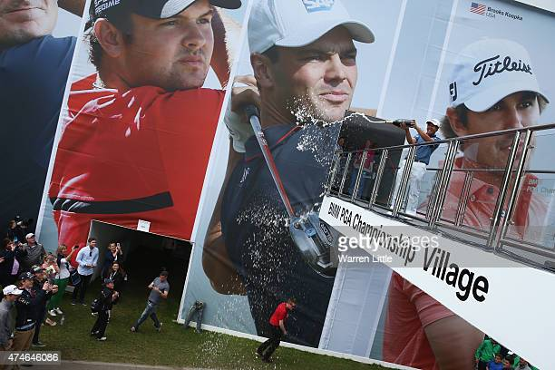 ByeongHun An of South Korea celebrates with champagne following his victory during day 4 of the BMW PGA Championship at Wentworth on May 24 2015 in...