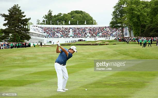ByeongHun An of South Korea hits his 3rd shot on the 18th hole during day 4 of the BMW PGA Championship at Wentworth on May 24 2015 in Virginia Water...
