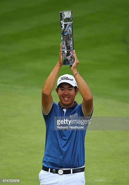 ByeongHun An of South Korea holds the trophy aloft following his victory during day 4 of the BMW PGA Championship at Wentworth on May 24 2015 in...