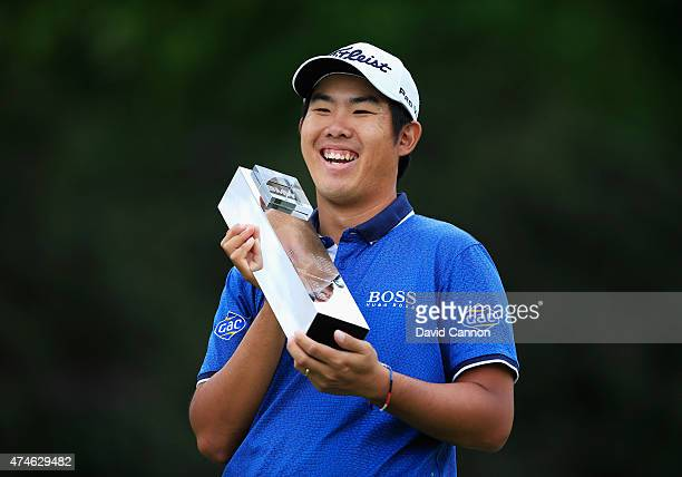 ByeongHun An of South Korea holds the trophy following his victory during day 4 of the BMW PGA Championship at Wentworth on May 24 2015 in Virginia...