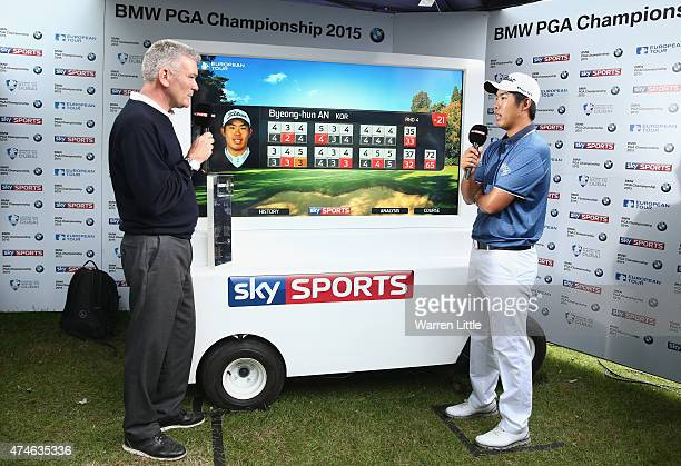 ByeongHun An of South Korea is interviewed by Tim Barter of Sky Sports following his victory during day 4 of the BMW PGA Championship at Wentworth on...