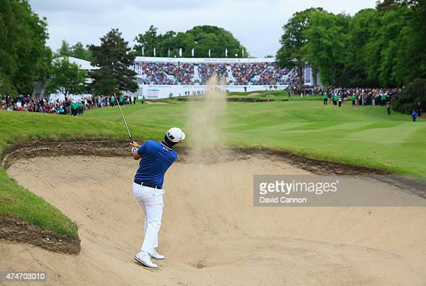 ByeongHun An of South Korea plays from a bunker on the 18th hole during day 4 of the BMW PGA Championship at Wentworth on May 24 2015 in Virginia...