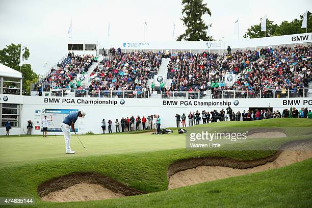 ByeongHun An of South Korea putts on the 18th green during day 4 of the BMW PGA Championship at Wentworth on May 24 2015 in Virginia Water England