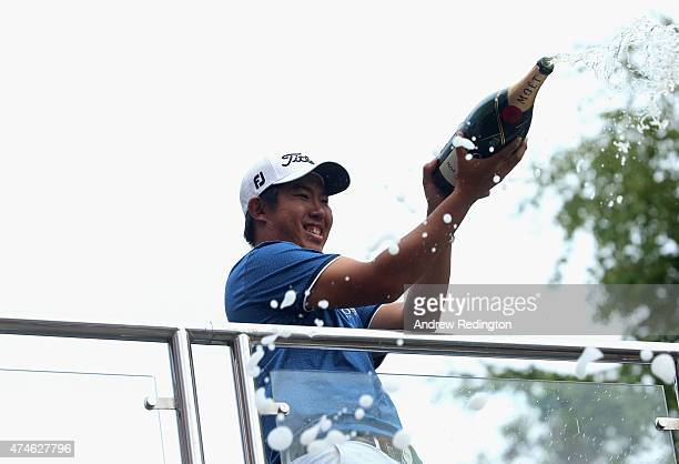 ByeongHun An of South Korea sprays champagne following his victory during day 4 of the BMW PGA Championship at Wentworth on May 24 2015 in Virginia...