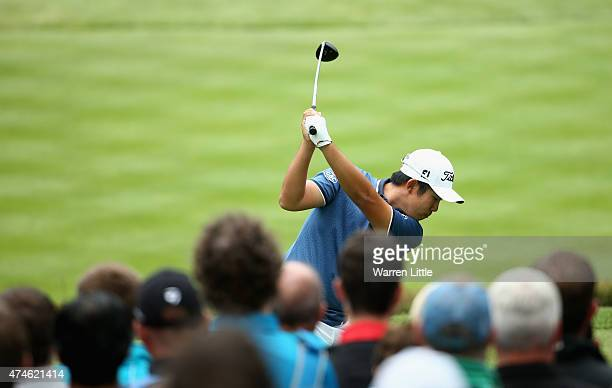 ByeongHun An of South Korea tees off on the 17th hole during day 4 of the BMW PGA Championship at Wentworth on May 24 2015 in Virginia Water England