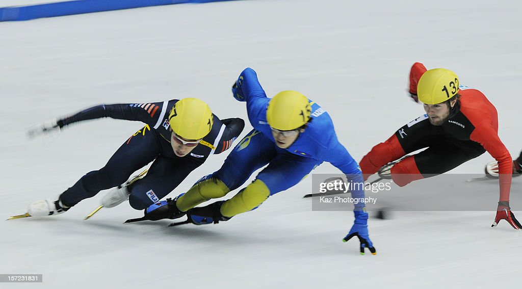 Byeong-Jun Kim of Korea passes Aydar Bekzhanov of Kazakhstan and Paul Herrmann of Germany in Race 5 of Men 1500m(1) Heats during day one of the ISU World Cup Short Track at Nippon Gaishi Arena on November 30, 2012 in Nagoya, Japan.