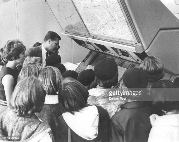 Byrd demonstrates to the members of the troop how air traffic is watched on radar and moved through the sectors controlled by the Longmont air...