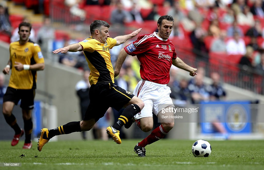 Byron Anthony of Newport battles with Glenn Little of Wrexham during the Blue Square Bet Premier Conference Play-off Final match between Wrexham and Newport County A.F.C at Wembley Stadium on May 05, 2013 in London, England.