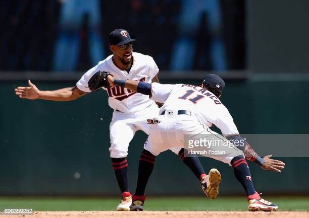 Byron Buxton and Jorge Polanco of the Minnesota Twins celebrate wining the game against the Seattle Mariners on June 15 2017 at Target Field in...