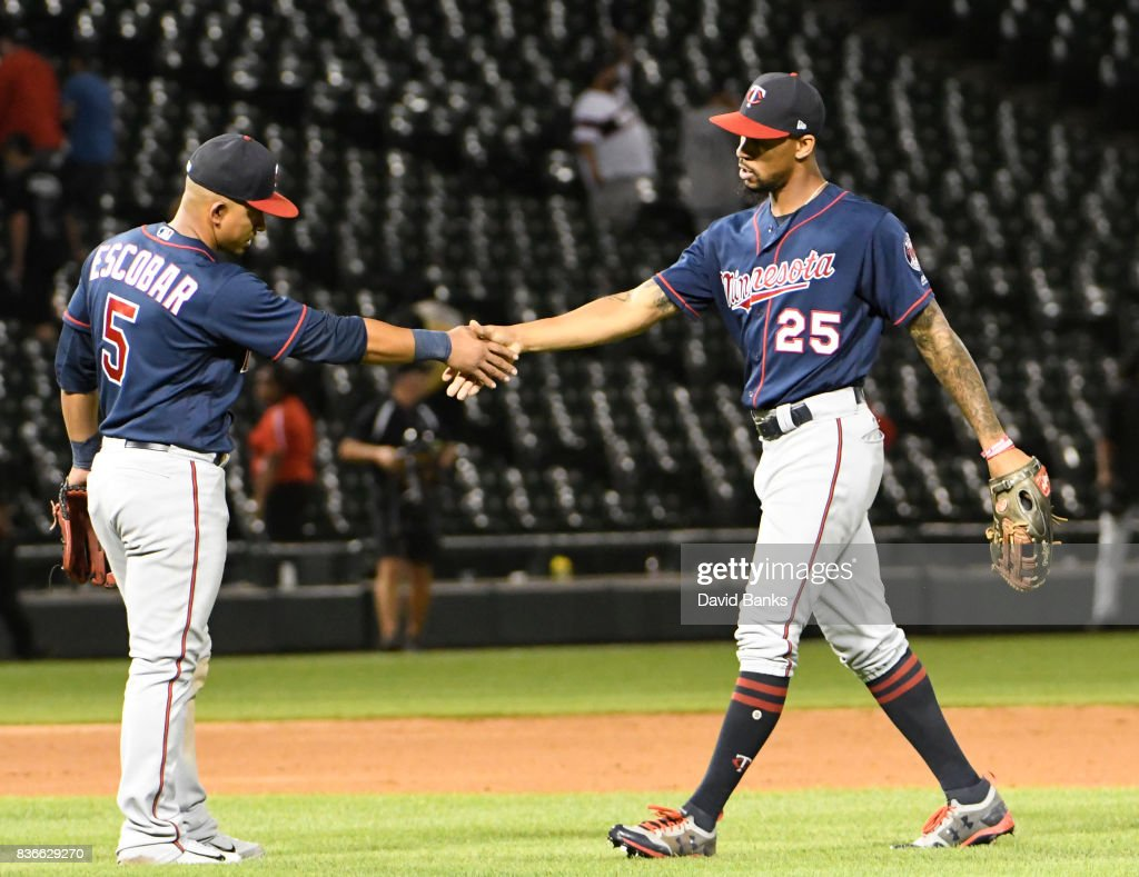 Byron Buxton #25 of the Minnesota Twins and Eduardo Escobar #5 of the Minnesota Twinsi celebrate their win against the Chicago White Sox in game two of a doubleheader on August 21, 2017 at Guaranteed Rate Field in Chicago, Illinois. The Twins defeated the White Sox 10-2.