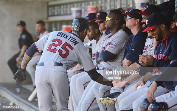 Byron Buxton of the Minnesota Twins gets the silent treatment from his teammates in the dugout after hitting his first major league home run during...