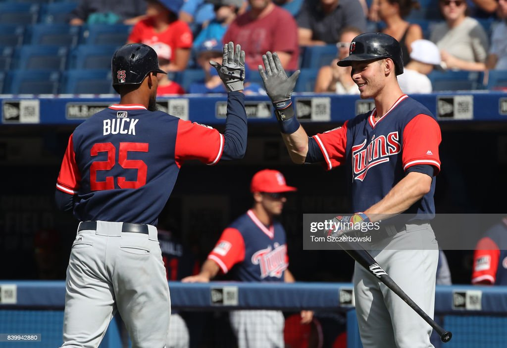 Byron Buxton #25 of the Minnesota Twins is congratulated by Max Kepler #26 after hitting his third home run of the game a solo home run in the ninth inning during MLB game action against the Toronto Blue Jays at Rogers Centre on August 27, 2017 in Toronto, Canada.