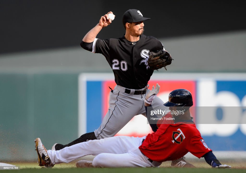 Byron Buxton #25 of the Minnesota Twins is out at second base as Tyler Saladino #20 of the Chicago White Sox turns a double play during the seventh inning of the game on April 16, 2017 at Target Field in Minneapolis, Minnesota. The White Sox defeated the Twins 3-1 in ten innings.