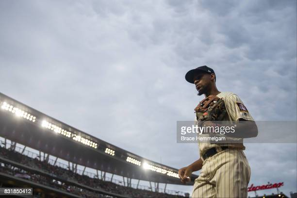 Byron Buxton of the Minnesota Twins looks on against the Texas Rangers on August 5 2017 at Target Field in Minneapolis Minnesota The Rangers defeated...