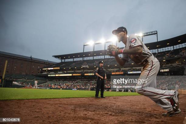 Byron Buxton of the Minnesota Twins looks on and takes the field against the Baltimore Orioles on May 23 2017 at Oriole Park at Camden Yards in...