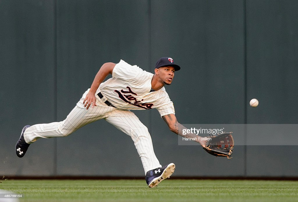 Byron Buxton #25 of the Minnesota Twins makes a catch in center field of the ball hit by Jed Lowrie #8 of the Houston Astros during the second inning of the game on August 29, 2015 at Target Field in Minneapolis, Minnesota.