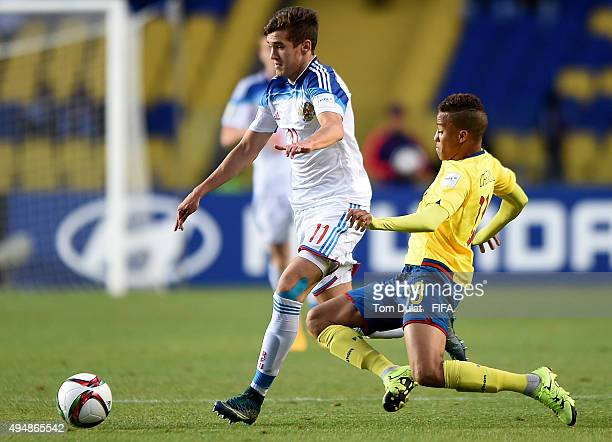 Byron Castillo of Ecuador and Alexander Lomovitskiy of Russia in action during the FIFA U17 World Cup Chile 2015 Round of 16 match between Russia and...