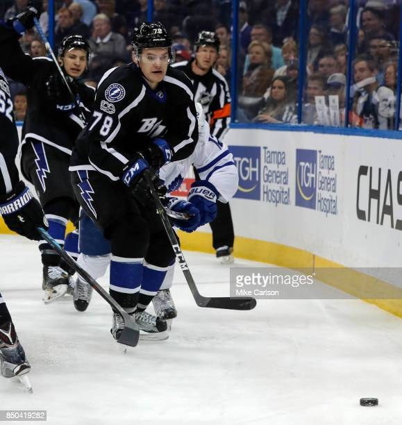 Byron Froese of the Tampa Bay Lightning looks for the puck against the Toronto Maple Leafs during the first period at the Amalie Arena on March 16...