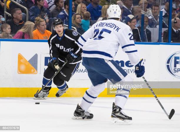 Byron Froese of the Tampa Bay Lightning skates against James van Riemsdyk of the Toronto Maple Leafs during the first period at Amalie Arena on March...