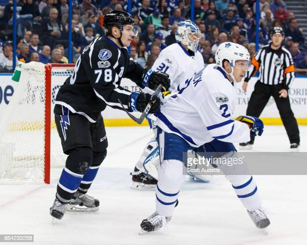 Byron Froese of the Tampa Bay Lightning skates against Matt Hunwick of the Toronto Maple Leafs during the first period at Amalie Arena on March 16...