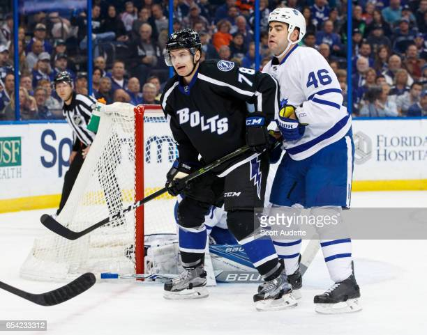 Byron Froese of the Tampa Bay Lightning skates against Roman Polak of the Toronto Maple Leafs during the first period at Amalie Arena on March 16...