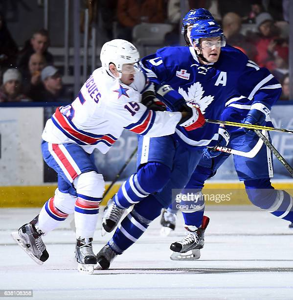 Byron Froese of the Toronto Marlies gets held up by Evan Rodrigues of the Rochester Americans during AHL game action on January 8 2017 at Ricoh...