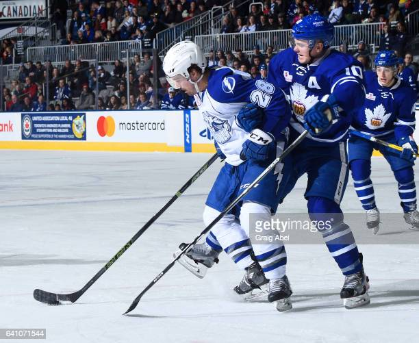 Byron Froese of the Toronto Marlies puts a hold on Mike Halmo of the Syracuse Crunch during AHL game action on February 4 2017 at Ricoh Coliseum in...