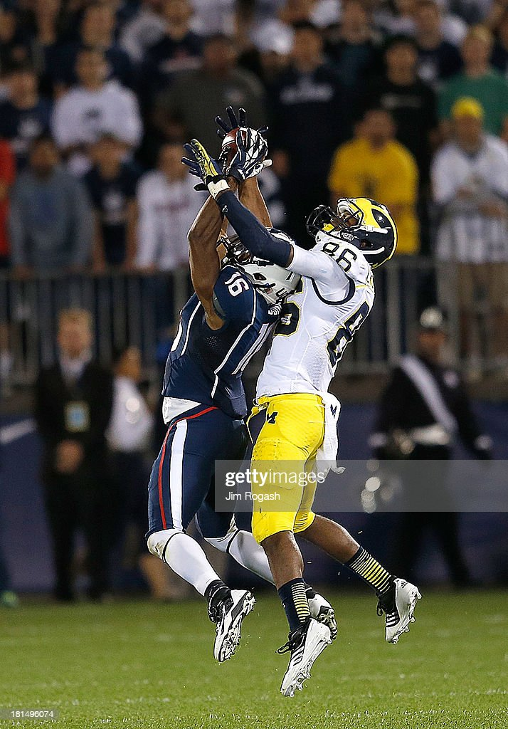 Byron Jones #16 of the Connecticut Huskies intercepts a pass intended for Jehu Chesson #86 of the Michigan Wolverines in the 1st half at Rentschler Field on September 21, 2013 in East Hartford, Connecticut.